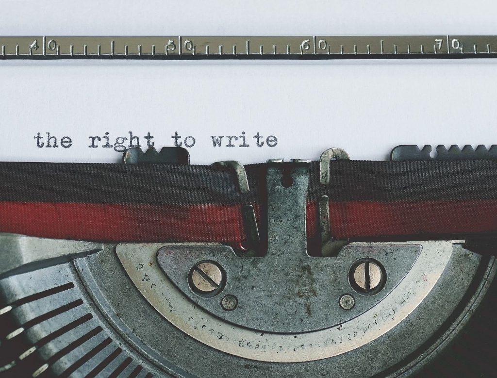 "closeup of typewriter with text ""the right to write"""